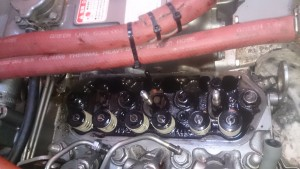 Valve train and tappets removed. Fuel lines disassembled,