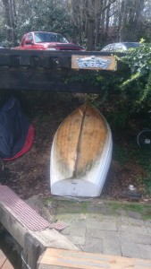 Our dinghy, unscrubbed and stored under the abandoned railway tracks that run along lake union.