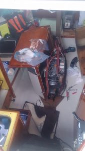 Opening the main cabin table, where the engine lives, to replace the fuel filter, again.